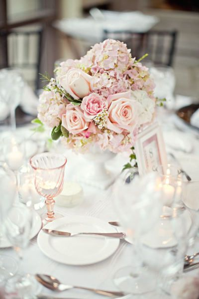 Soft pink flowers in a milk glass vase wedding stuff