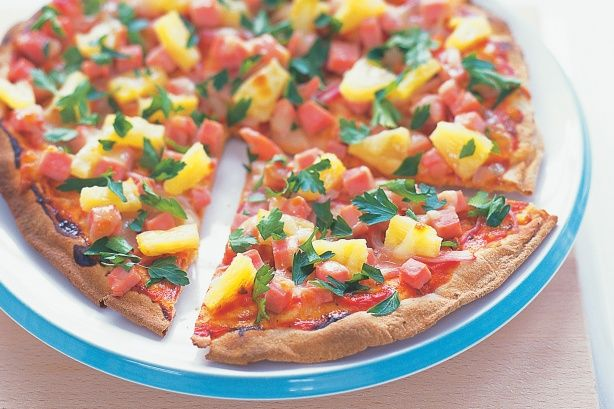 Lebanese bread pizza, top with whatever you like. Super quick and easy ...