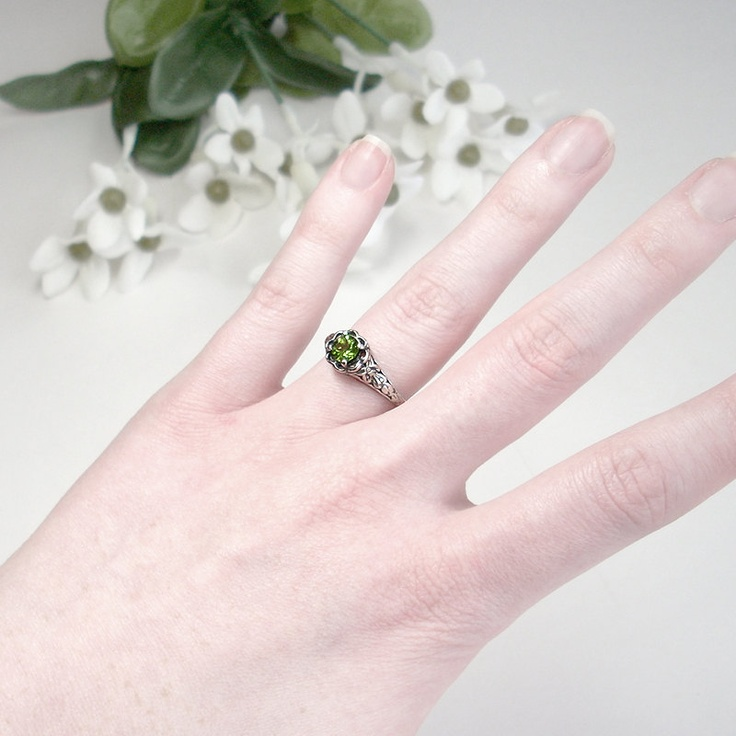 Sterling Peridot Ring: Sterling Silver and Genuine Peridot - size 5.5, light green, round, gemstone, vintage ring, antique ring, filigree. $64.00, via Etsy.