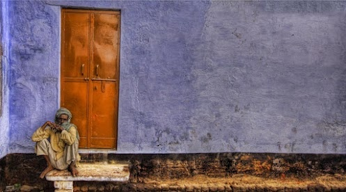 Man sitting outside his front door in Northern India....by Trey Ratcliff