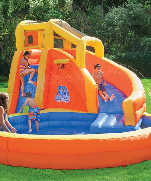 the backyard water park featuring a climbing wall water cannon