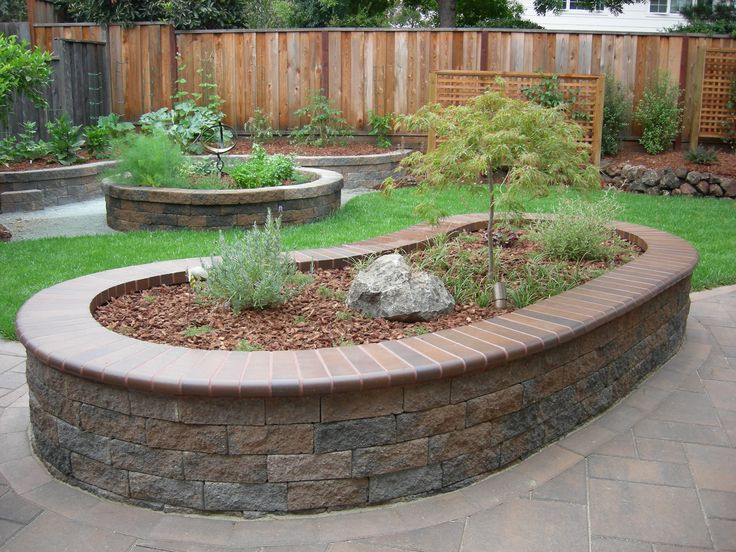 Pretty raised beds made out of pavers outside stuff for Pretty raised beds