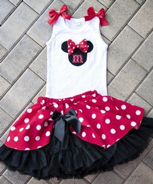 Beautiful Disney outfits and other dresses for girls.  Plus puppies??? Strange but neat.