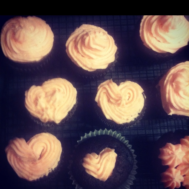 Dark chocolate cupcakes with raspberry cream cheese frosting :)