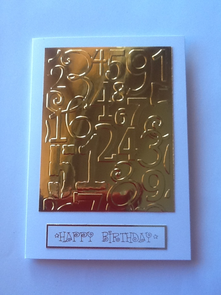 Cuttlebug embossing folder, gold foil card stock  and sentiment..