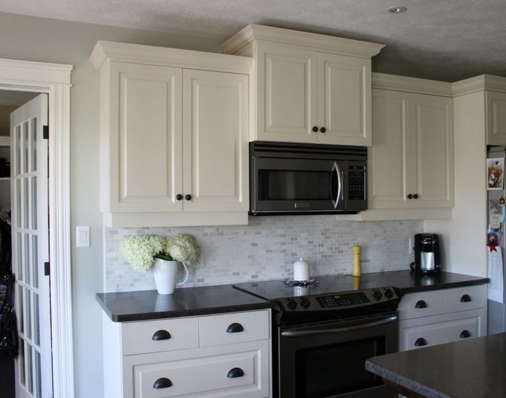 My kitchen White cabinets, dark counters, dark drawer pulls