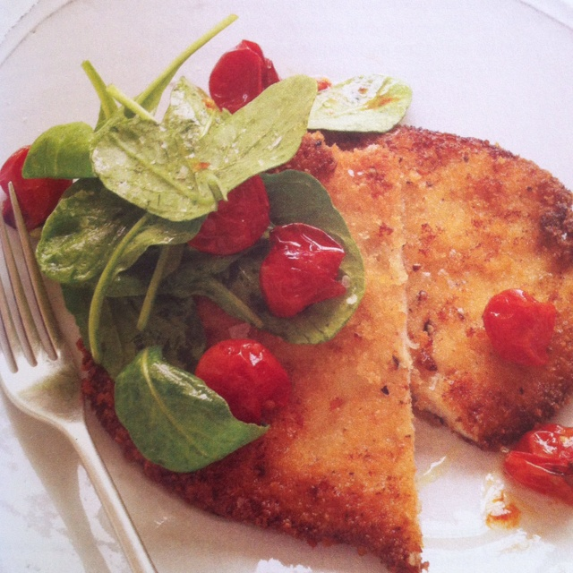 Chicken Milanese with slow roasted cherry tomatoes and arugula....
