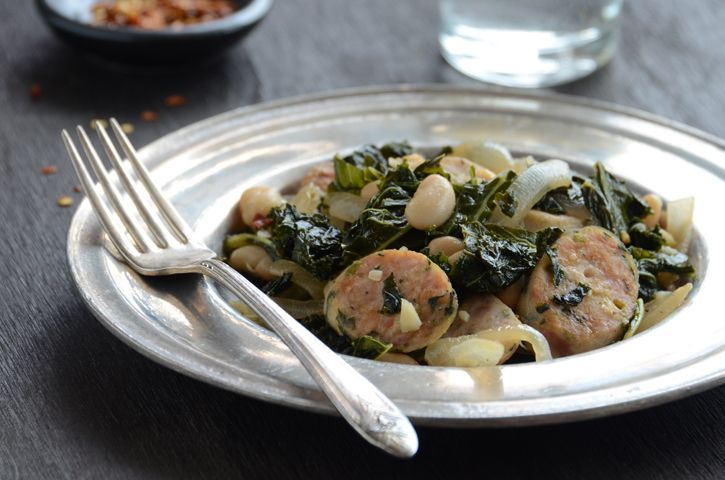 Sautéed kale with sausage and white beans.