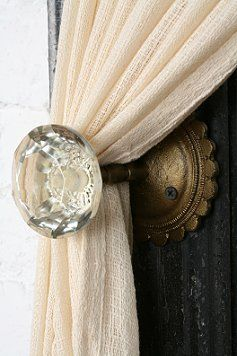 Door knob for curtain tie back