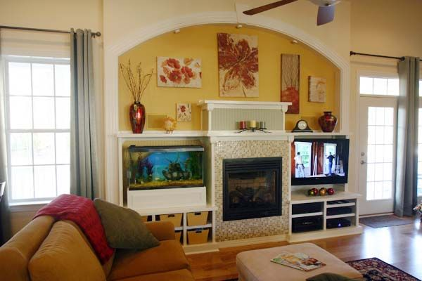 Best built ins before and afters 2013 for Fish tank fireplace