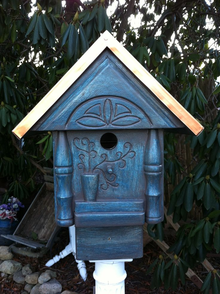 Gorgeous and unique birdhouses made using recycled for Creative birdhouses