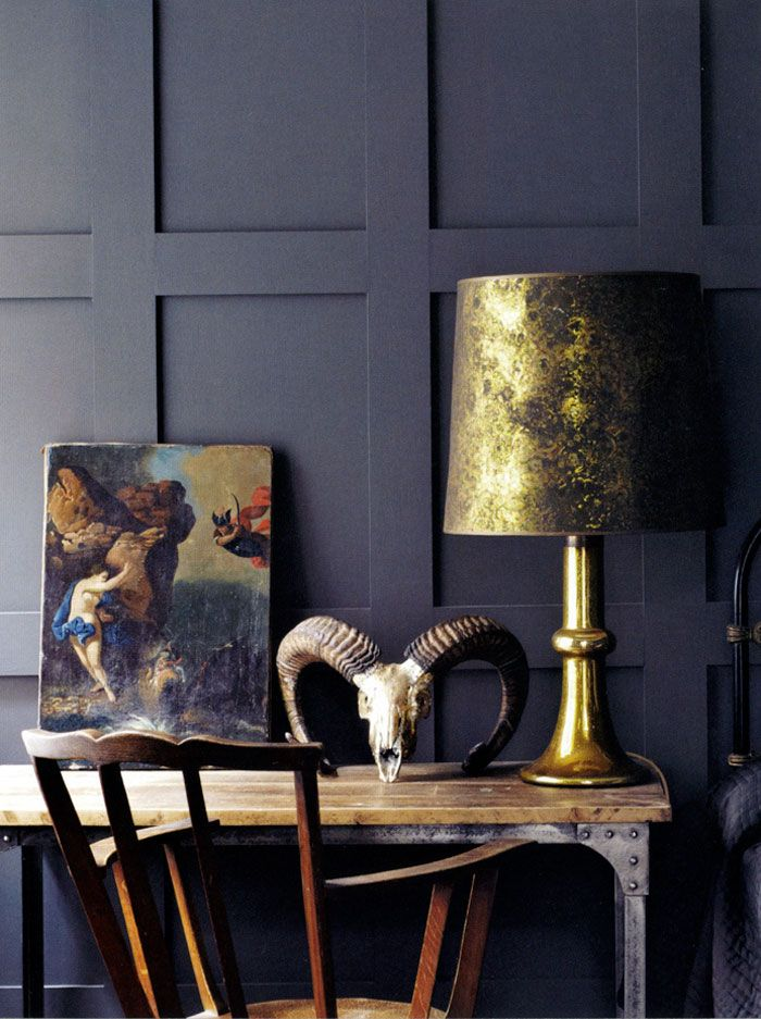 My love affair with matte black walls knows no bounds. Old canvas salvaged from the market in Arezzo, aged gold, horned skull.