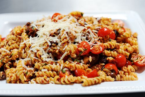 Sundried Tomato Pasta Salad - tangy sundried tomato dressing poured ...