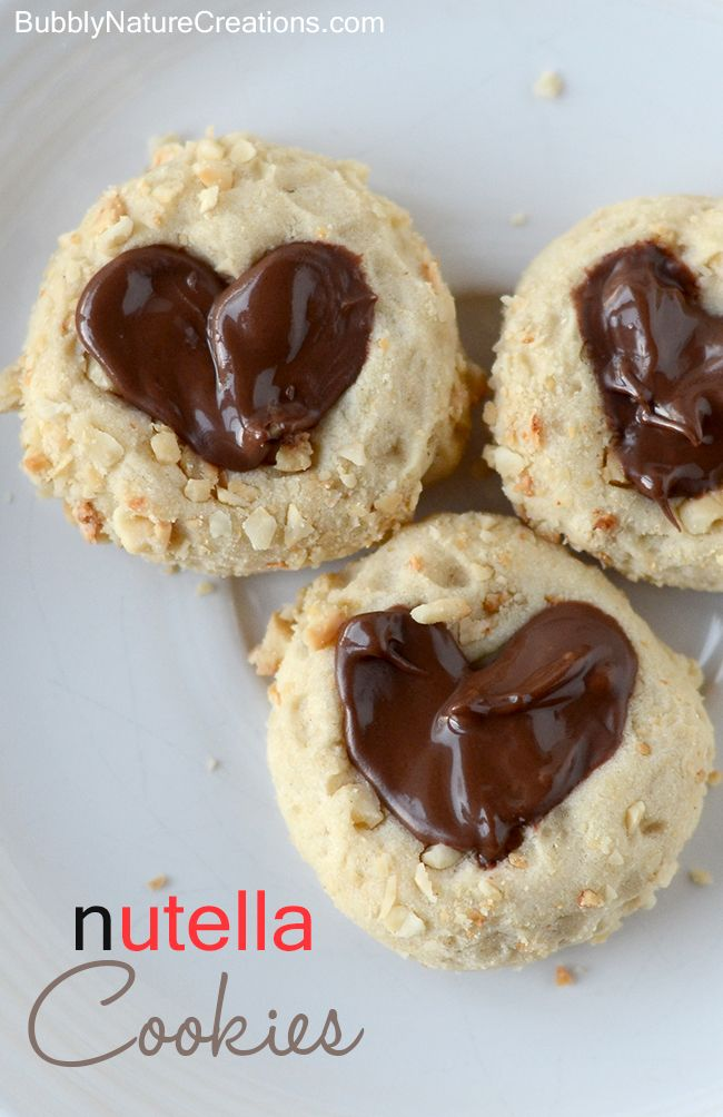 Nutella Cookies! Thumbprint cookies rolled in hazelnuts and filled ...