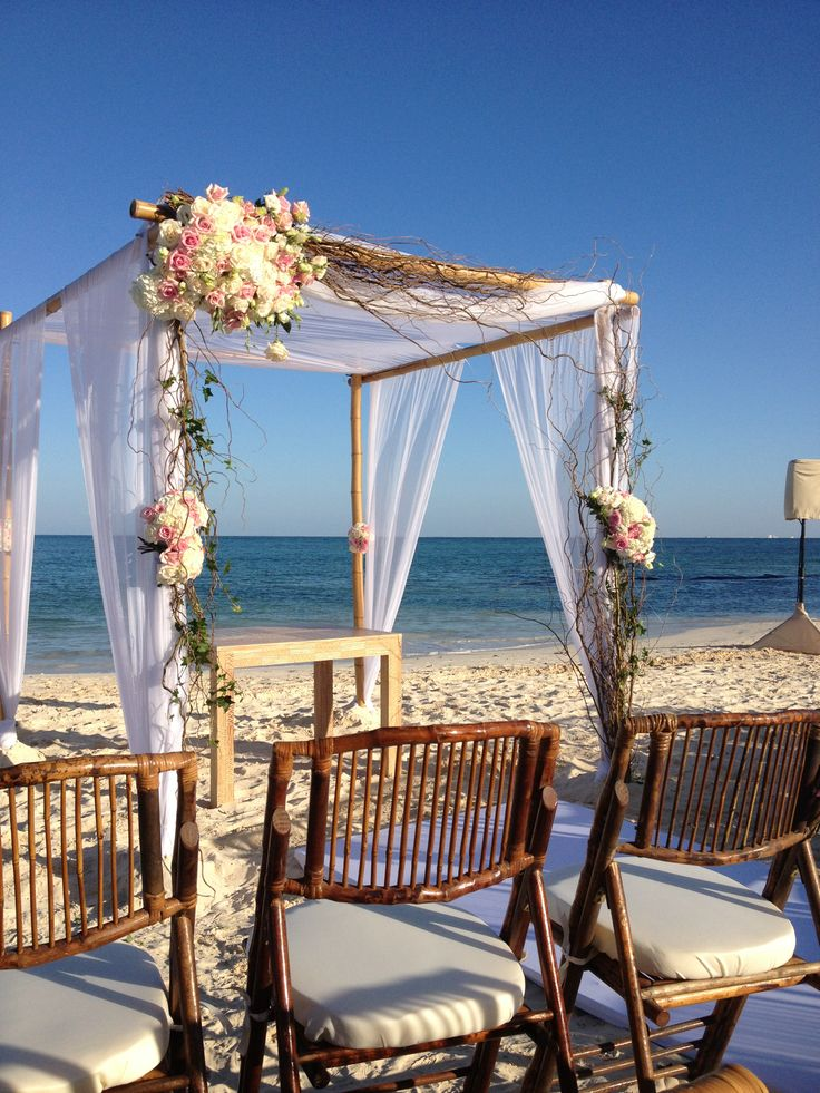 DELUXE natural & romantic ashymmetric gazebo ceremony set up. Bamboo chairs to have a cohesive look.