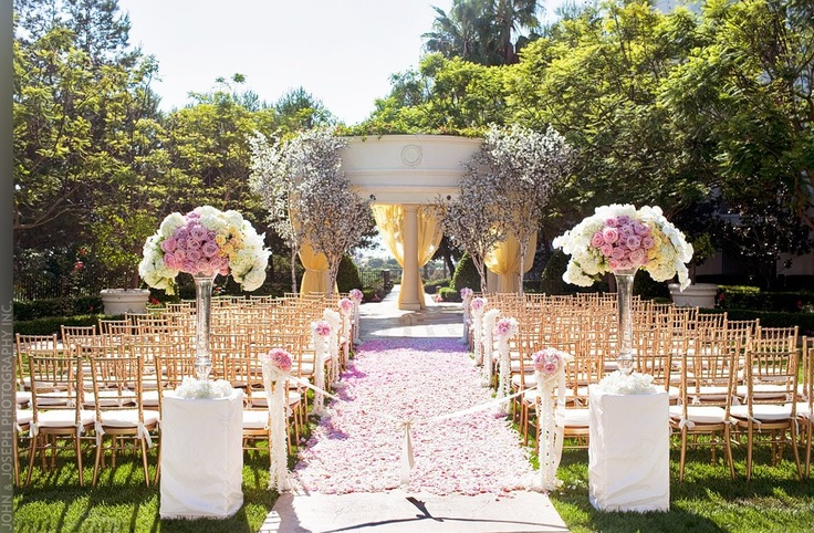 Pink and white flowers with gold chiavari chairs for wedding ceremony