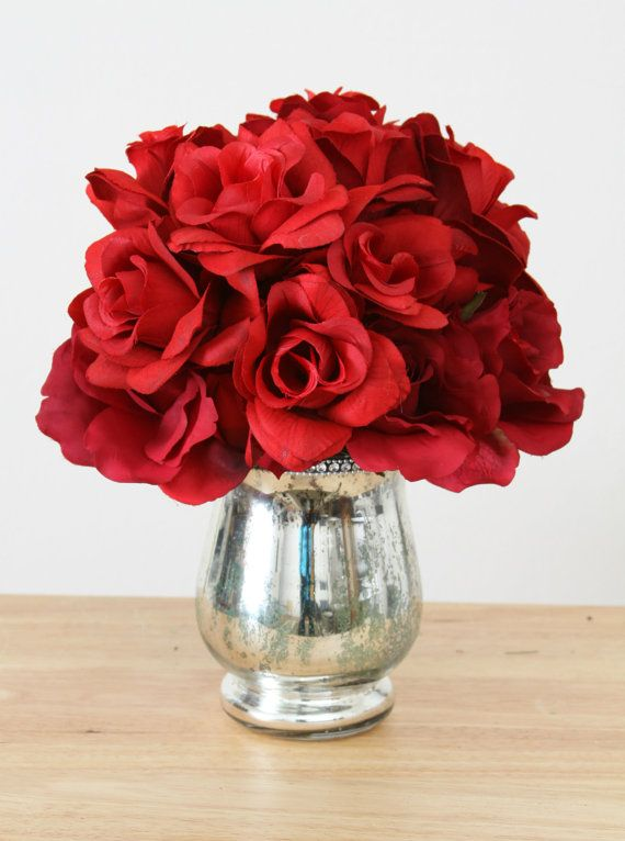 Red silk roses in silver vase tabletop centerpiece