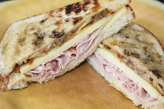 grilled gruyere cheese, ham, and caramelized onion sandwich