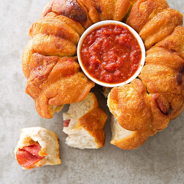 We love the pull-apart breakfast version of traditional Monkey Bread, but Pizza Monkey Bread? Now that's bananas!