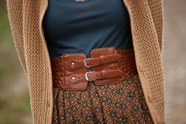 Wide leather belt, solid shirt, patterned skirt, solid cardigan.  Love these colors together.