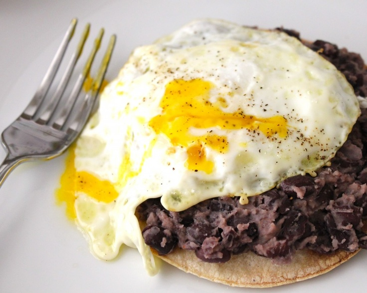 Tostada topped with black beans and egg over easy. Yum!