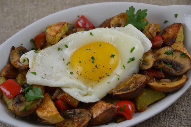 ... Fingerling Potatoes Topped with Spicy Vegetables and a Fried Egg