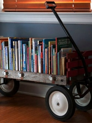 Make a library cart on wheels with a wagon. The nice thing about wagons is they can accommodate even the largest story books. Plus, can storage get any cuter?