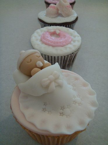 I made these for little Brandon's shower...  Baby Shower Cupcakes