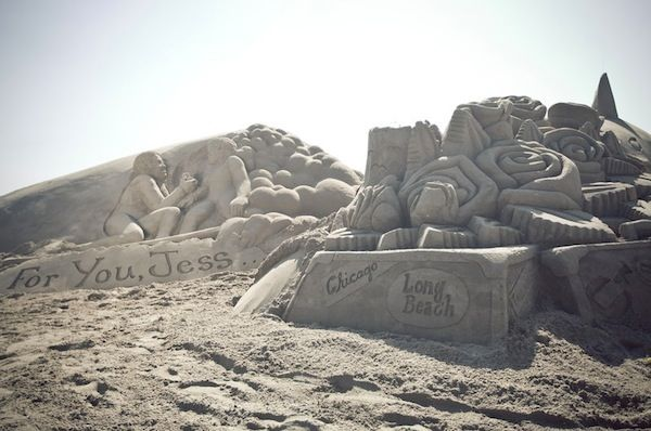 A giant sand castle created just for her of all of her favorite things. Marriage Proposal by The Yes Girls