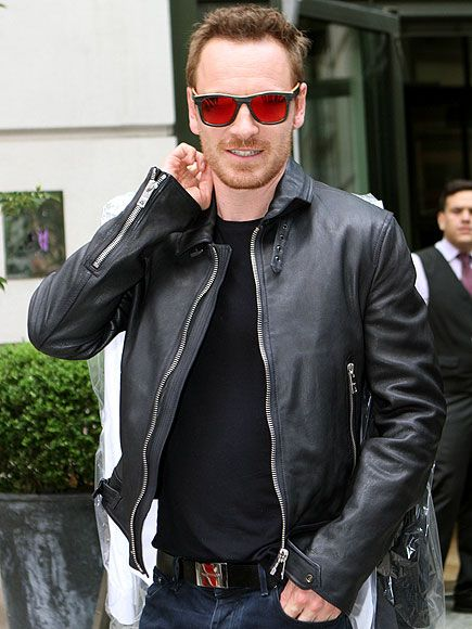 Michael Fassbender made a FLASHY statement in sunnies boasting bright red mirrored lenses! How badass?!