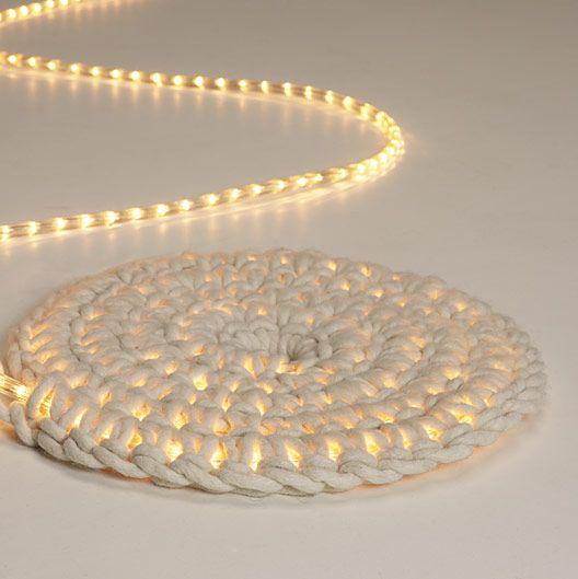 Crochet around an LED rope light using a thick spun wool to create a super cool kid's room nightlight or luminescent outdoor mat. #DIY | grosgrainfabulous.blogspot.com