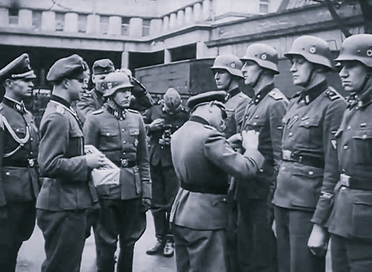 "Waffen SS Gen. Josef ""Sepp"" Dietrich decorates men of the Waffen SS Division ""Leibstandarte SS Adolf Hitler."""