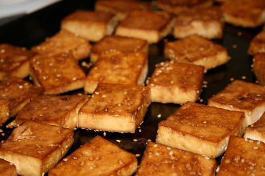 ... of panko and sesame seeds on a plate coat the tofu slices and bake
