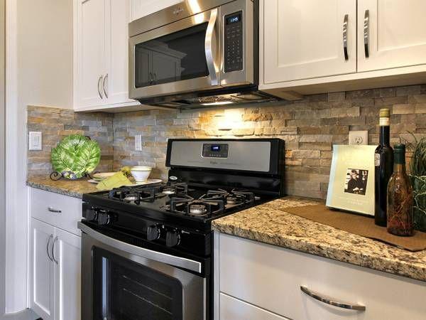 tumbled stone backsplash gas stove kitchen pinterest