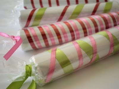 Wrap a roll of lifesavers in white paper, ribbon, and cellophane - stocking stuffer