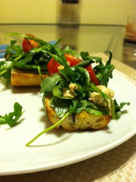 Mozzarella, tomato and arugula bruschetta. Simply tossed w EVOO ...