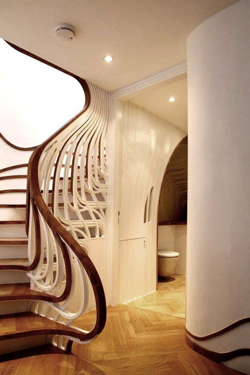 Stairs may serve a utilitarian purpose, but this breath-taking set of treads by UK-based Atmos Studio takes it to new heights. Designed as part of a residential project, the stairs seem to come alive as it turns the corner, unravelling sculptural elements that organically encase and animate the transitional space