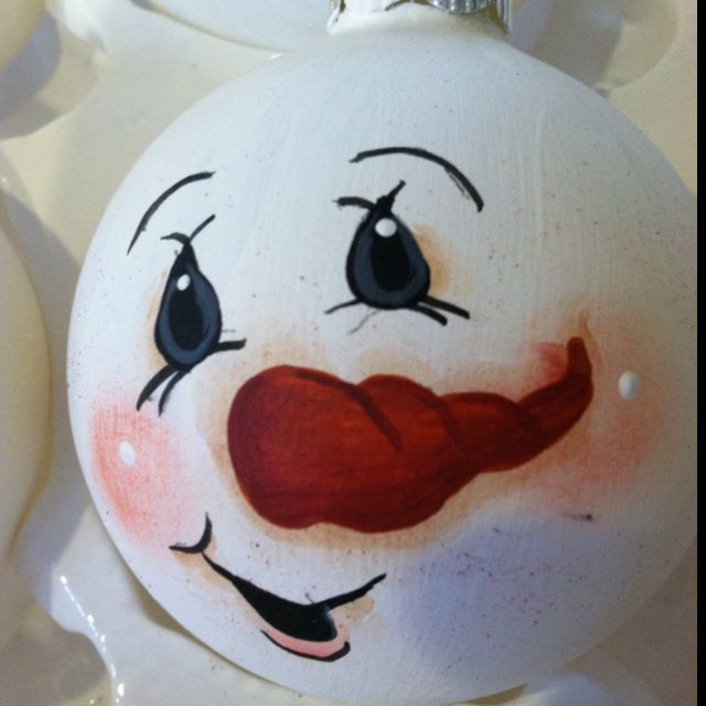 painted snowman face in glass ornament ball using acrylic paint