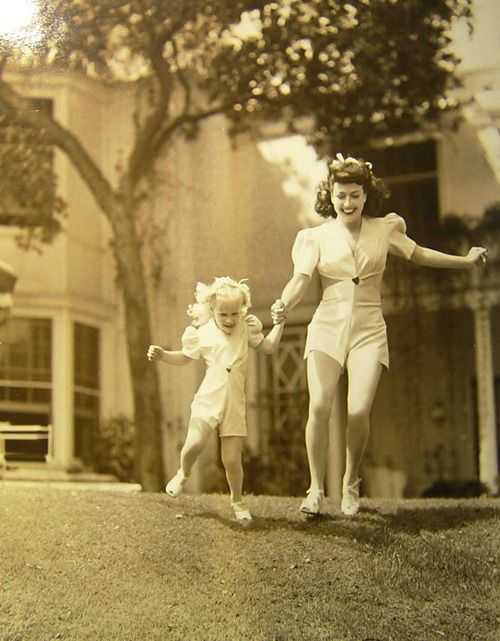 Joan Crawford and her adopted daughter, Christina, wearing matching outfits in 1943