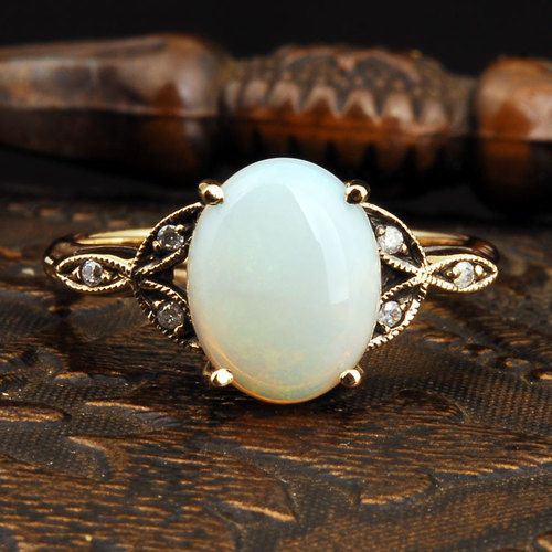 vintage opal + diamond gold ring.