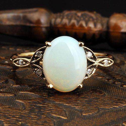 vintage opal + diamond gold ring.