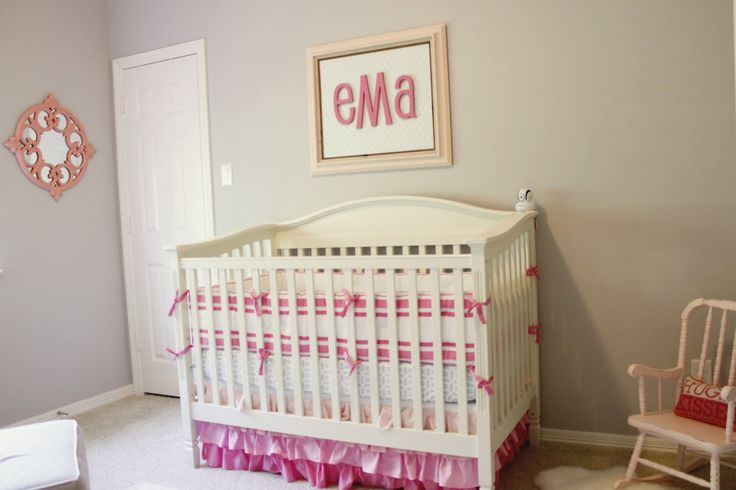Love the simple, bright monogram over the crib in this girly nursery!
