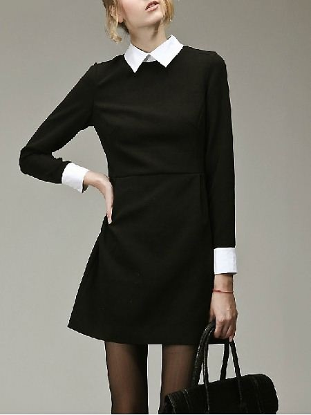 Black dress over a white collar shirt and then add three or four