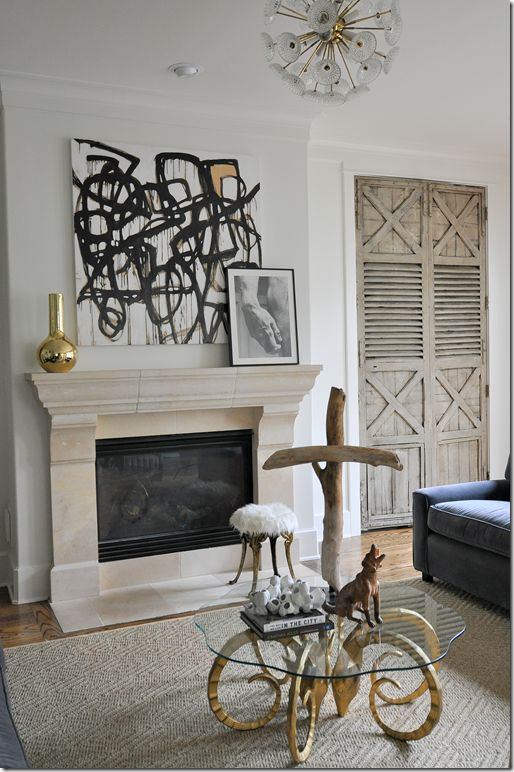 Those antique shutters are amazing!  Plus I love the driftwood cross.