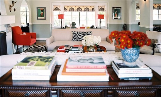 A zesty tangerine chair adds a pop of color. By interior designer Betsy Burnham.