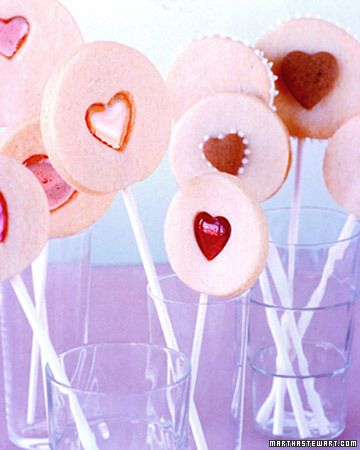 "Sweetheart Cookie Pops from Martha Stewart Living with recipe and instructions (via link) ~ Adorable. These appear to be tinted sugar cookies with ""stained glass"" look centers on some of them in pink and rose."