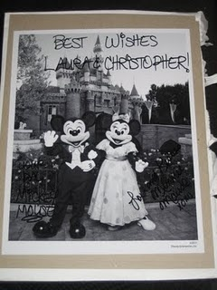 GREATEST THING EVER. If you send Mickey and Minnie an invitation to your wedding, they'll send you an autographed photo! Cute!