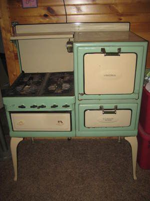 AnTiQuE VINTAGE 1920's 30's UNIVERSAL OLD GAS STOVE WHITE & GREEN PORCELAIN. It's a mini version of @Phoebe Rose Faden's!
