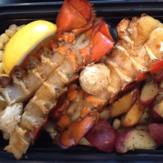 Cedar planked lobster tails with potlatch (Pacific style herb ...