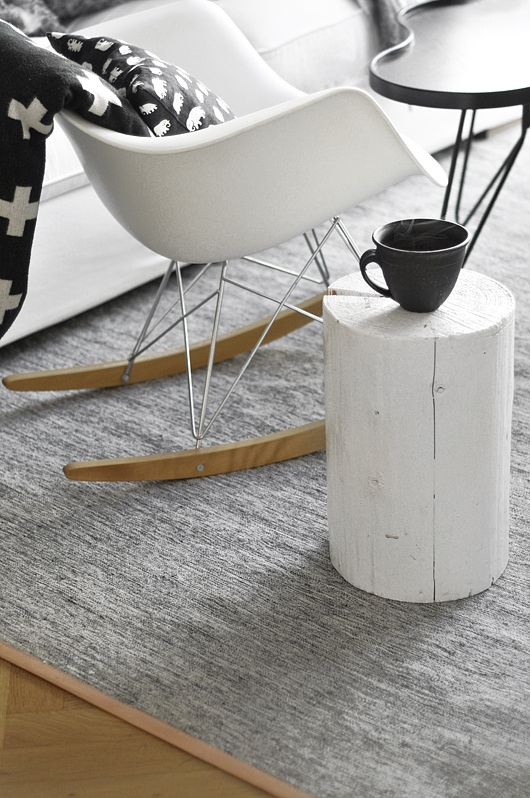Love this white log as a small coffee table. A table to move around the room where it's needed, for a cup of tea or a book.